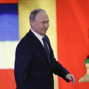Vladimir Putin přichází na výroční tiskovou konferenci