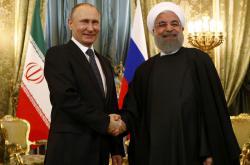 Vladimir Putin a Hasan Rouhání