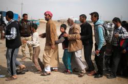 Civilisté prchající z Mosulu