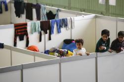 Život uprchlíků v ubytovnách na Tempelhofu