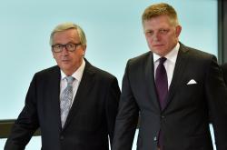 Šéf EK Jean-Claude Juncker a slovenský premiér Robert Fico