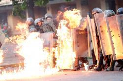 Bezpečnostní složky během protestů v Caracasu