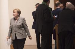 Kancléřka Angela Merkelová během rozhovorů o vzniku koalice