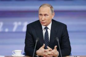 Vladimir Putin odpovídá na dotazy novinářů