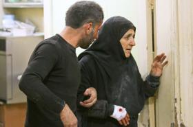 Zraněná žena ve východním Aleppu