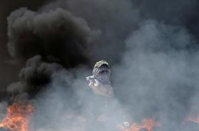 Palestinská demonstrantka v Pásmu Gazy