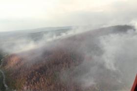 Následky požáru v Krasnojarském kraji