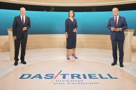 Olaf Scholz (SPD), Annalena Baerbocková (Zelení) a Armin Laschet (CDU/CSU)