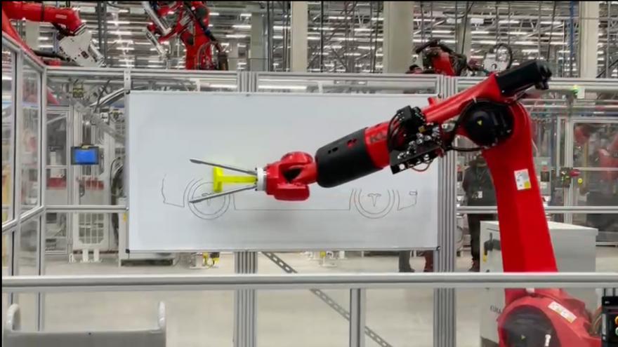Video Výrobní roboti v Gigafactory  zatím nová elektroauta vyrábět nemohou