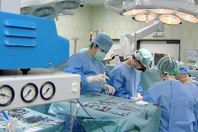 Lékaři v nemocnici