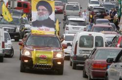 Transparenty s vůdce Hizballáhu v Libanonu