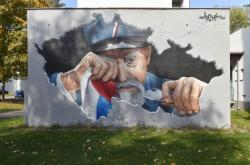 Graffiti plačícího Masaryka v Olomouci