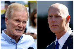Floridští kandidáti na post senátora - demokrat Bill Nelson a republikán Rick Scott
