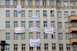 Protest v ulici Karla Marxe v Berlíně