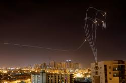 Hamas rockets being intercepted by Israeli missiles