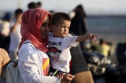 Uprchlice s dítětem v Řecku