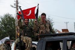 Tureckem podporovaní syrští rebelové