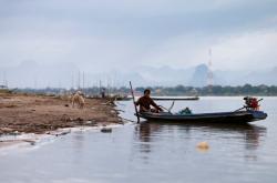 Thajský rybář na řece Mekong