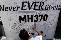 Příbuzní pasažérů letu MH370 neztrácejí naději