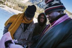 Migranti přecházejí Alpy