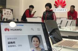 Fotografie Meng Wan-čou na notebooku firmy Huawei