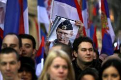 Srbský příznivec Putina s jeho fotkou