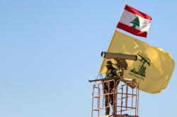 Bojovník Hizballáhu na syrsko-libanonských hranicích