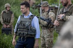 Volodymyr Zelenskyj u fronty na východě Ukrajiny na konci května