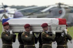 Vojenský speciál přepravil 10. července 2014 pozůstatky čtyř českých vojáků
