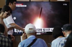Lidé v Soulu sledují televizní vysílání o severokorejském testu