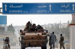 Příslušníci syrské armády obsazují pozice dosud kontrolované Kurdy