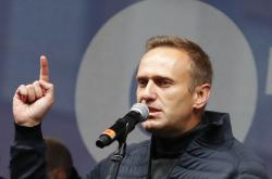 Alexej Navalnyj na mítinku na podporu vězněných demonstrantů z konce září