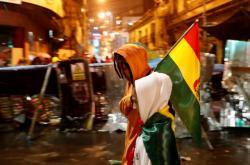 Demonstranti proti Moralesovi v centru hlavního města La Paz