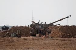 Izraelští vojáci blízko hranic s Gazou