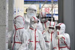 Hygienici v jihokorejském městě Tegu