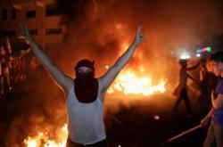 Palestinec na protiizraelské demonstraci v Gaze