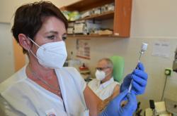 Posilující dávka vakcíny proti covidu-19
