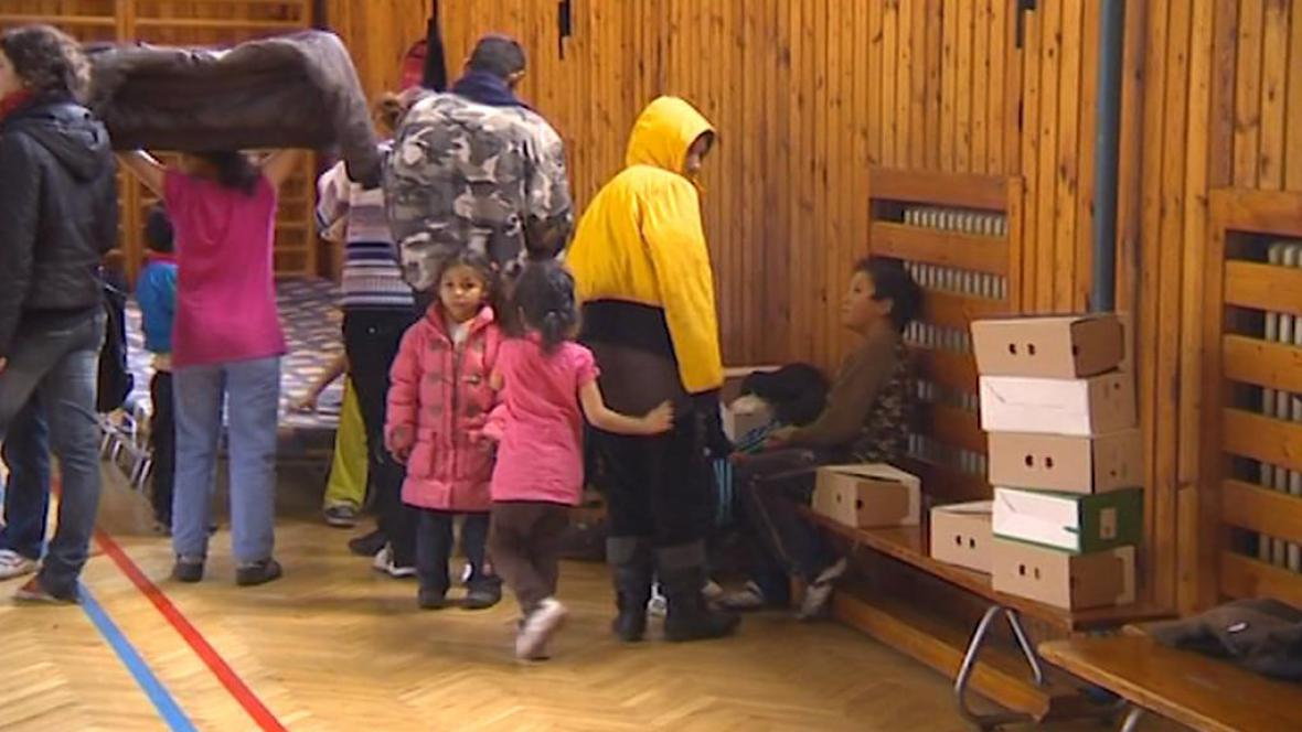 Evakuovaní lidé při povodních