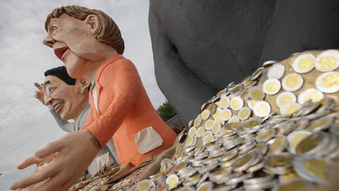 Figurky Angely Merkelové a Philippa Roeslera