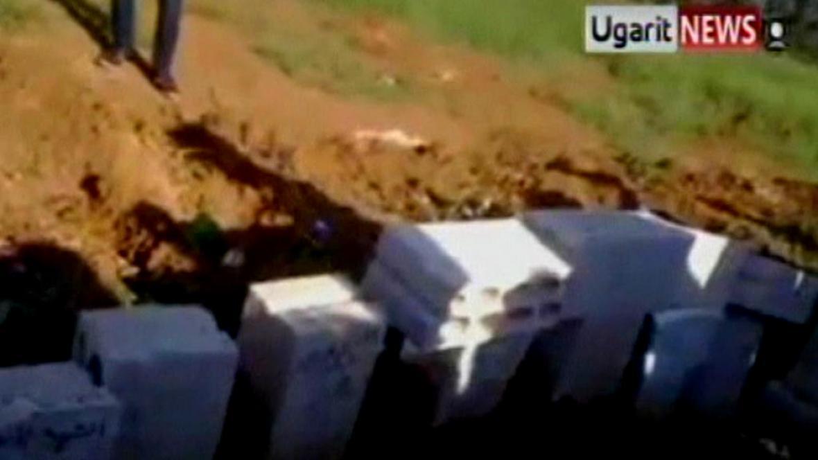 Masový hrob v Sýrii