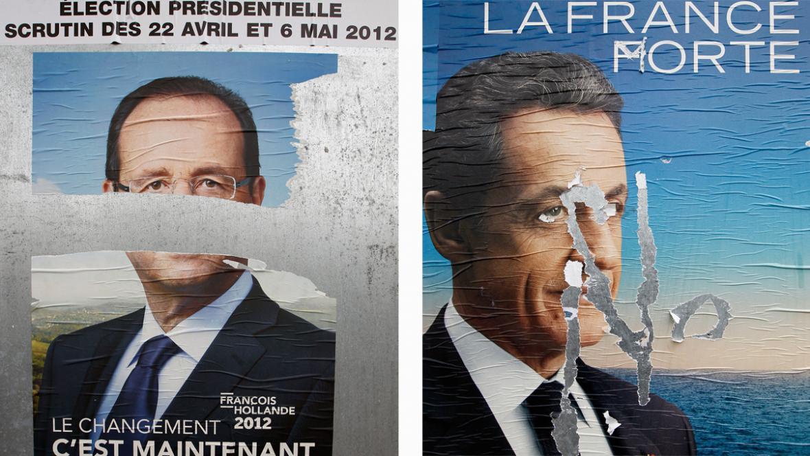 Poškozené plakáty Hollanda a Sarkozyho