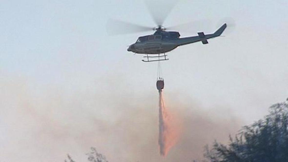 Hašení lesního požáru