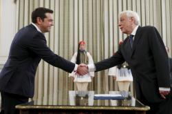 Vítěz řeckých voleb Alexis Tsipras a prezident Prokopis Pavlopulos