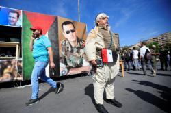 Mítink stoupenců Asada v Damašku