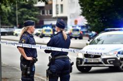 Policie na místě činu ve městě Malmö, kde se odehrála střelba