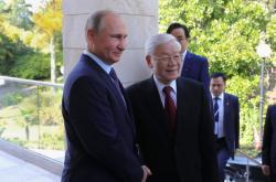 Ruský prezident Vladimir Putin a generální tajemník Nguyen Phu Trong