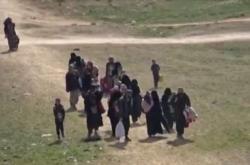 Civilisté u syrské vesnice Baghúz