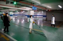 Dezinfekce parkovišť ve městě Čchang-ša
