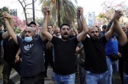 Protest v libanonském Bejrútu (snímek ze 14. října)