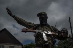 Proruský ozbrojenec ve městě Slavjansk